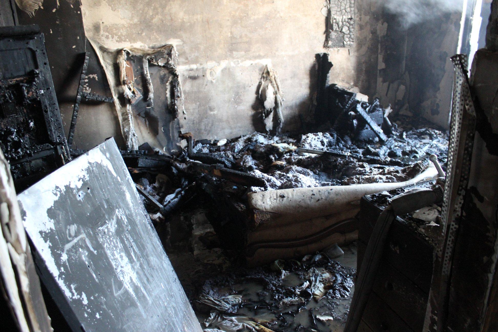 FOTO/VIDEO O femeie de 73 de ani, salvată dintr-un incendiu care a izbucnit în capitală