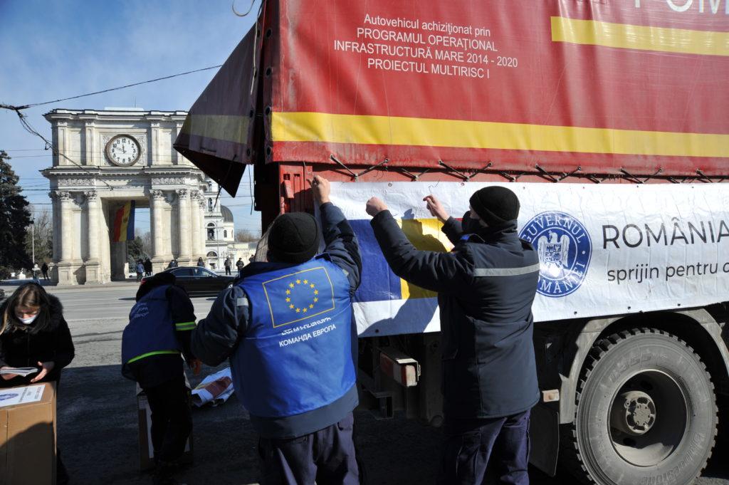 Reportaj FOTO. Cum a fost întâmpinat lotul de ajutor umanitar oferit de România